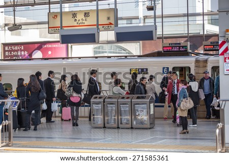 TOKYO, JAPAN - CIRCA APR, 2013: People stand in queue for boarding the Hikari Shinkansen to the Kyoto city. The Tokyo Station is a railway station in the Marunouchi district of Chiyoda - stock photo