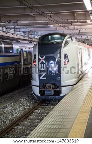 TOKYO, JAPAN - CIRCA APRIL, 2013: Narita Express (NEX) shinkansen is a bullet train from Tokyo city to airport in Narita on circa April, 2013 in Tokyo, Japan.  - stock photo