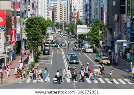 TOKYO, JAPAN - CIRCA AUGUST 2014: Unidentified people crossing streets. - stock photo