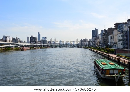 TOKYO, JAPAN, circa May 2015: Boat docked on an unknown river in Tokyo, Japan