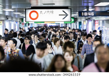 TOKYO, JAPAN - CIRCA MAY 2014: Passengers hurry at Ikebukuro station in Tokyo, Japan. Ikebukuru is the second-busiest railway station in the world - stock photo