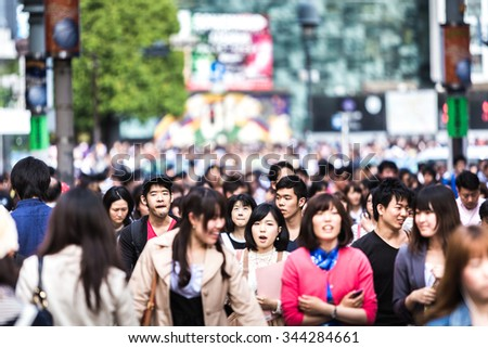 TOKYO, JAPAN - CIRCA MAY 2014: People walking at a busy street in Tokyo, Japan. - stock photo