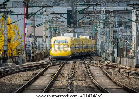 TOKYO, Japan - DEC 6, 2015: Doctor Yellow, a special Shinkansen, is approaching to Tokyo station. - stock photo