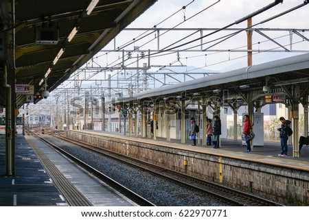 Tokyo, Japan - Dec 25, 2015. People waiting for the train at Hachioji railway station in Tokyo, Japan. Railways are the most important means of passenger transportation in Japan.