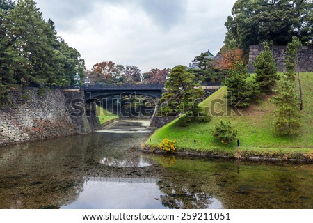 TOKYO, JAPAN - DEC 01, 2014: Seimon Ishibashi bridge attached to Imperial Place in Tokyo, Japan. Edo Castle, also known as Chiyoda Castle, is a flatland castle that was built in 1457. - stock photo