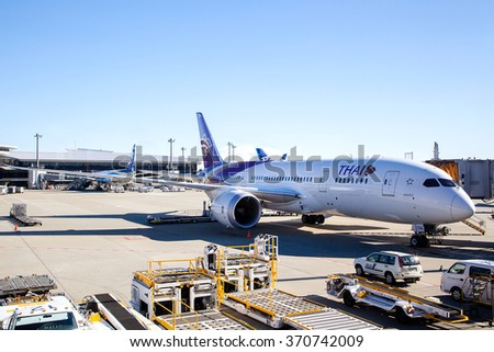 TOKYO, JAPAN - DECEMBER 5: A THAI Airways plane on the tarmac of Tokyo Narita Airport Dec. 5, 2014. Formed in 1988, THAI Airways was the first Asia-Pacific airline to serve London Heathrow Airport.