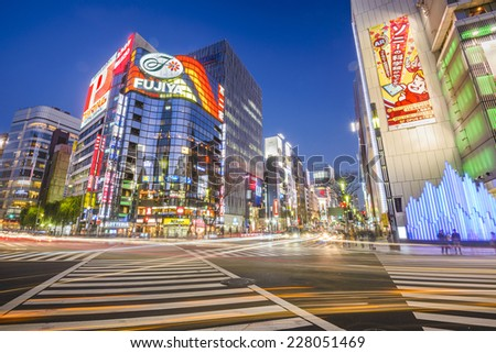 TOKYO, JAPAN - DECEMBER 25, 2012: Cityscape in the Ginza District. The district offers high end retail shopping. - stock photo