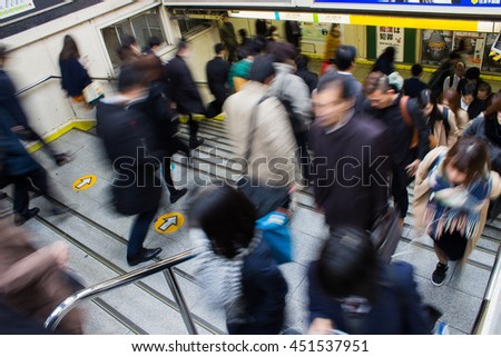 TOKYO, JAPAN - DECEMBER 8, 2015: Passengers hurry at Akihabara station in Tokyo, Japan, Blurred abstract background of many people at train station - stock photo