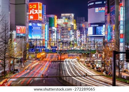 TOKYO, JAPAN - DECEMBER 29, 2012: Shinjuku district illuminated at night. The district is a renown night life center. - stock photo