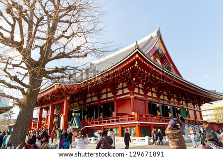 TOKYO, JAPAN - FEBBRUARY 23: The Buddhist Temple Senso-ji is the symbol of Asakusa and attracting thousands of tourists on February 23, 2013 in Tokyo, Japan. - stock photo