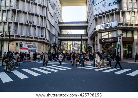 TOKYO, JAPAN - February 16, 2016:Intersection people crossing a road in Shibuya. - stock photo