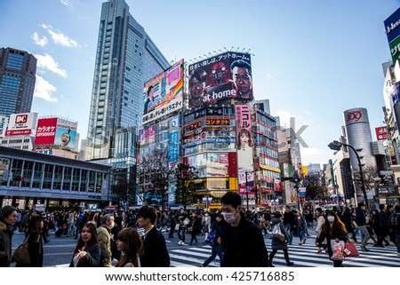TOKYO, JAPAN - February 16, 2016:People Crossing Famous Shibuya Cross. The scramble crosswalk is one of the largest in the world. - stock photo