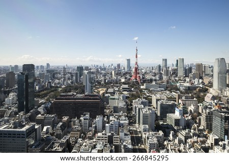 TOKYO, JAPAN - 19 FEBRUARY 2015 - The Tokyo tower in the Kanto region and Tokyo prefecture, is the first largest metropolitan area in Japan. Downtown Tokyo is very modern with many skyscrapers. - stock photo