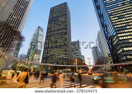 Tokyo, Japan - January 13, 2016: Commuters rushing home after office hours  in Shinjuku, Tokyo - Japan. - stock photo