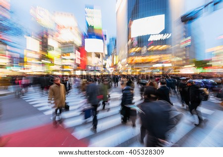 Tokyo, Japan - January 17, 2016: Evening rush hour at the famous Shibuya Crossing in Tokyo, Japan. This area is known as one of the fashion centers of Japan. Zoom in blur! - stock photo