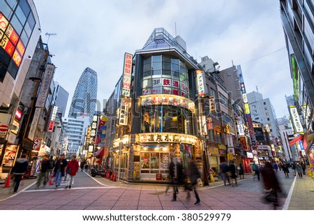 Tokyo; Japan -January 11; 2016: Street view of Nishi Shinjuku Shopping street whith several Japanese Restaurants on the sides. Mode Gakuen Cocoon Tower is at the background.  - stock photo