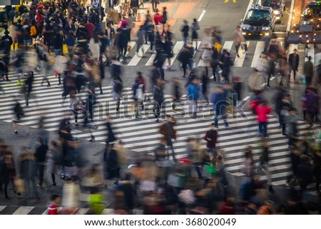 TOKYO, JAPAN - JANUARY 9: Topview view of Shibuya Crossing in Shibuya Tokyo on January 9, 2016, one of the busiest crosswalks in the world. - stock photo