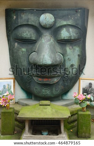 TOKYO, JAPAN - JULY 22 : Face of the Ueno Great Buddha on 22 July 2016. at Tokyo, Japan.Ueno Great Buddha was destroyed by the 1923 earthquake, only the face remained.