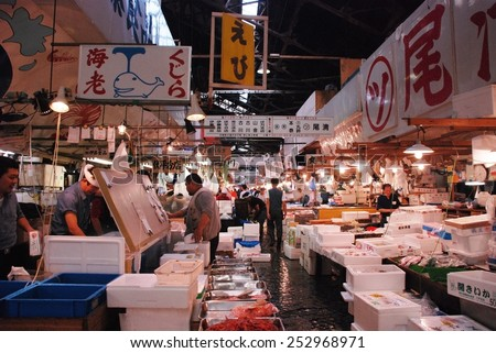 TOKYO, JAPAN - JULY 22 : Fish sale at Tsukiji Market, the biggest wholesale market in Japan taken July 22, 2008 in Tokyo, Japan. - stock photo