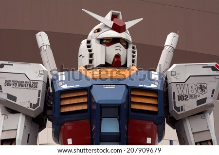 TOKYO, JAPAN - JULY 10: Gundam anime figure in Odaiba on 10 July 2014. at Tokyo, Japan. Anime is a popular type of animation or cartoon in Japan. - stock photo