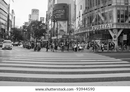 TOKYO, JAPAN - JULY 21: Shibuya crossing is one of the most famed examples of a scramble crosswalk in the world on July 21, 2011 in Tokyo, Japan. - stock photo