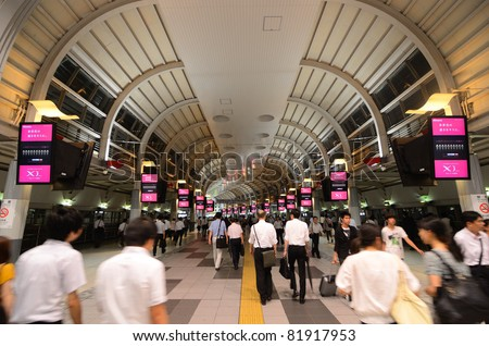 TOKYO, JAPAN - JULY 19: Shinagawa Station is the first major station south of Tokyo station and will be a terminal for the future planned Maglev train July 19, 2011 in Tokyo, Japan. - stock photo