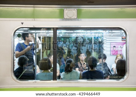 TOKYO, JAPAN - June 19 2016: Busy commuter  train at Shinjuku station. This is the busiest train station in the world and 3.4 million people pass through it each day. In Tokyo, Japan 2016 - stock photo