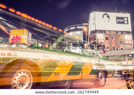 TOKYO,JAPAN - MARCH 10,2015: A Taxi at Shinjuku District December 25, 2012 in Tokyo, Shinjuku is one of the world's best known shopping districts. - stock photo