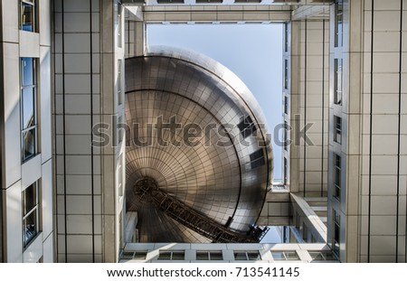 TOKYO, JAPAN - MARCH 24, 2014: Bottom view on Corporate Headquarters of Fuji TV at Odaiba island.Tokyo, Japan