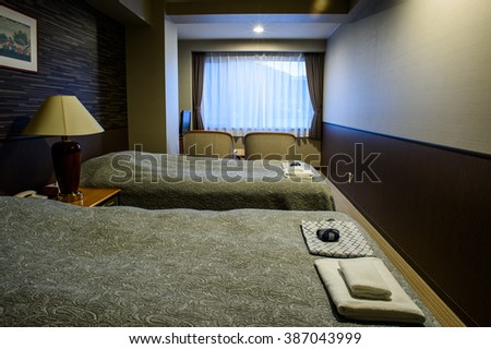 TOKYO, JAPAN - 03 MARCH 2016- Editorial: Fantastic bedroom interior with white bed at Tominako Hotel