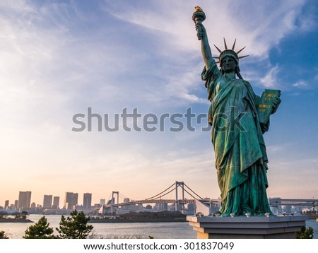 TOKYO; JAPAN - MARCH 30: Liberty statue in Odaiba on March 30; 2015 in Tokyo; Japan.It is a large artificial island in Tokyo Bay, Japan, across the Rainbow Bridge from central Tokyo. - stock photo