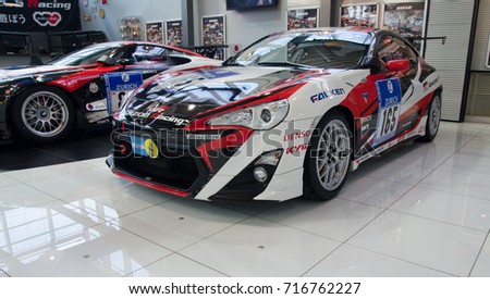TOKYO, JAPAN   MARCH 24, 2014: Racing Sports Car Presented In Odaiba  Showroom