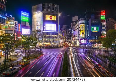 TOKYO, JAPAN - MARCH 30, 2014: Shibuya Ward at Shibuya crossing is one of Tokyo's major nightlife and fashion centers. - stock photo