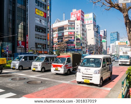 TOKYO; JAPAN - MARCH 30: Shinjuku district on March 30; 2015 in Tokyo; Japan. It is a major commercial and administrative centre, housing the busiest railway station in the world.  - stock photo
