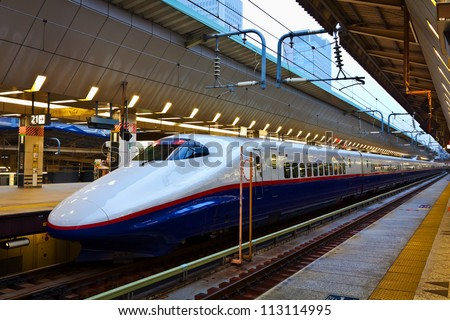 TOKYO, JAPAN - MARCH 24: Shinkansen in Tokyo, Japan on March 24, 2012. Japan's main islands, are served by a network of high speed train lines that connect Tokyo with most of the major cities. - stock photo
