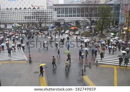 TOKYO, JAPAN - MARCH 8 : Unidentified pedestrians at Shibuya crossing on November 8, 2014 in Tokyo, Japan. The famous scramble crosswalk is used by over 2.5 million people daily. - stock photo