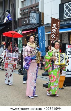 TOKYO, JAPAN - MARCH 10, 2016: Young Japanese women wearing traditional Kimono at Asakusa Street. - stock photo