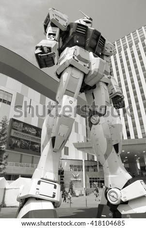 TOKYO, JAPAN - MAY 11, 2012: Gundam robot replica in Tokyo. The sculpture is 18m tall and is the tallest replica of famous anime franchise robot, Gundam.