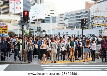 Tokyo ,Japan - May 25 ,2014. Many people cross the street and traffic light - stock photo