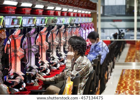 TOKYO, JAPAN - 16 MAY 2016 - Pachinko Parlor in Akasaka. It's a type of mechanical arcade game originating in Japan widely used as a recreational and gambling device.