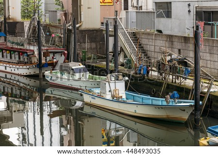 TOKYO, JAPAN - MAY 31: private boats parked under one of the bridges of Tokyo, Japan on May 31, 2016.