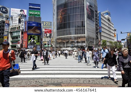 TOKYO, JAPAN - May 18, 2016: Shibuya Crossing is one of the busiest crosswalks in the world. This area is known as one of the fashion centers and major nightlife of Japan on May 18, 2016. - stock photo