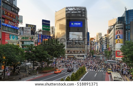 Tokyo, Japan, May 14, 2016: Shibuya Crossing Of City street at sunset  with crowd people on zebra crosswalk in Shibuya town. Shibuya is a special ward located in Tokyo for shopping at night.