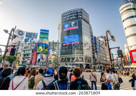 TOKYO,JAPAN -1 MaY 2014 :Shibuya is famous for its scramble crossing. It stops vehicles in all directions to allow pedestrians to inundate the entire intersection.  - stock photo