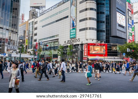 TOKYO,JAPAN - 11 May 2015:Shibuya is famous for its scramble crossing. It stops vehicles in all directions to allow pedestrians to inundate the entire intersection.