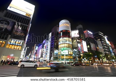 TOKYO, JAPAN - MAY 8, 2012: Shoppers visit Ginza district in Tokyo. Ginza is recognized as one of most luxurious shopping districts in the world, with many flagship luxury brand stores located here. - stock photo