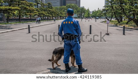 TOKYO, JAPAN - MAY 21ST, 2016. Security police at the Tokyo Imperial Palace grounds.