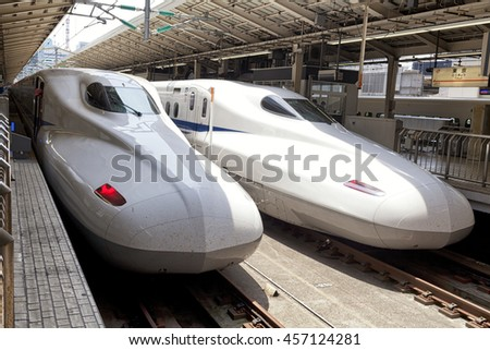 TOKYO, JAPAN - 19 MAY 2016 - Two N700 Series Shinkansen high-speed bullet trains operated by Central Japan Railway Company at Tokyo station.