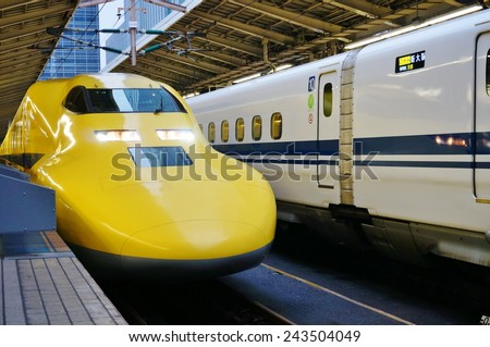 "TOKYO, JAPAN --1 NOVEMBER 2014-- A ""Doctor Yellow"" nozomi Shinkansen high-speed bullet train enters the Tokyo station, which celebrated its 100th anniversary in December 2014."