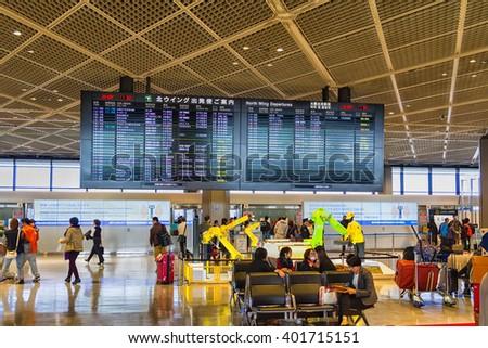 TOKYO, JAPAN - NOVEMBER 28: Airport departures board in Tokyo international airport, Japan on November 28, 2015 - stock photo